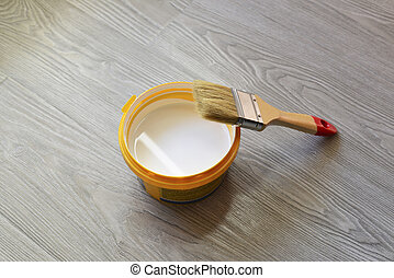 Bank with white paint and brush on  floor