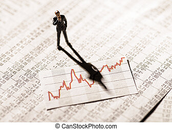 Banker looking at a graph with stock prices