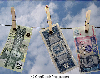 Banking - Banknotes from around the world hanging on a...