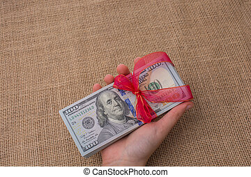 Banknote bundle of US dollar tied with a ribbon