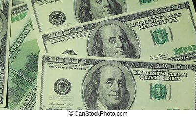 Banknote hundred dollars rotate in two levels - Closeup of...