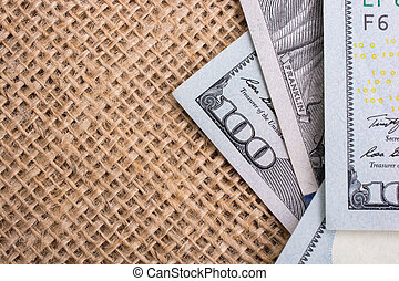 Banknote of US dollar on a linen canvas