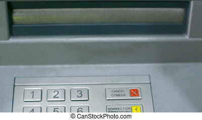 banknotes appear in ATM slot and woman takes money cash