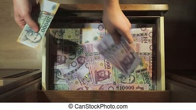 Pile of banknotes as a background (hungarian forint, 20000) kept in a drawer at home, grabbing money, high quality audio