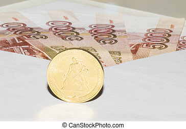 Banknotes in envelope and coin is c