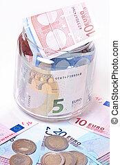 banknotes in jar