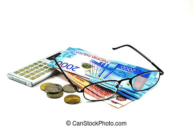 Banknotes of different denominations, calculator and glasses.