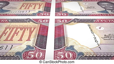 Banknotes of fifty dollar liberians of Liberia rolling, cash...