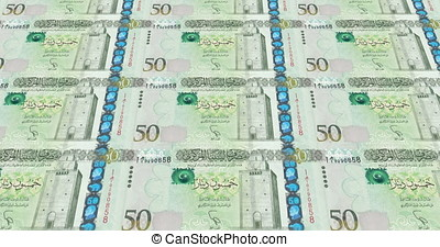 Banknotes of fifty libyan dinars of Libya rolling on screen,...