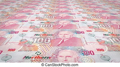 Banknotes of one hundred pounds of Northern Ireland rolling, cash money