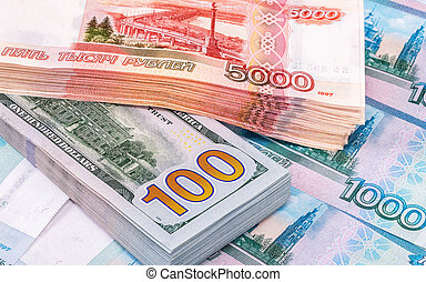 Banknotes of russian roubles and american dollars