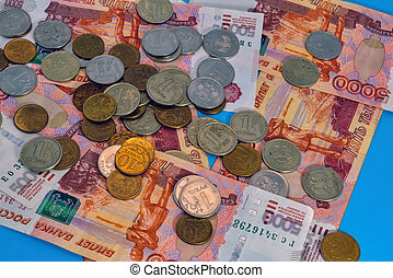 Banknotes of Russian rubles and coins close-up. Background of money.