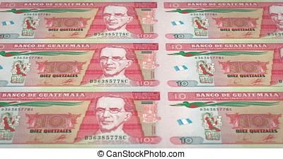 Banknotes of ten guatemalan quetzal of Guatemala rolling, cash money, loop
