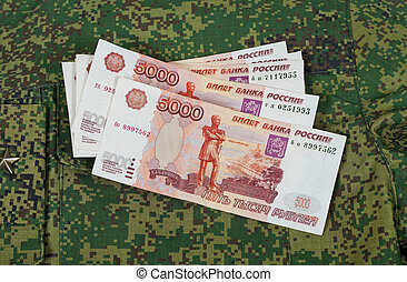 Banknotes on the military uniform