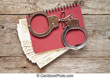 bankpapier, handcuffs, aantekenboekje, eurobiljet