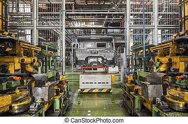 Bankrupt and abandoned automobile plant. The frame of the cab car on the production line