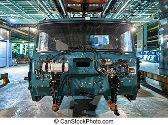 Bankrupt and abandoned automobile plant. The frame of the cab car on the production line.