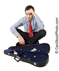 Desperate bankrupt businessman sitting by a violin case and a few coins - isolated