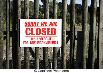 Bankrupt - Closed wooden gate. Business shut down. Sorry...