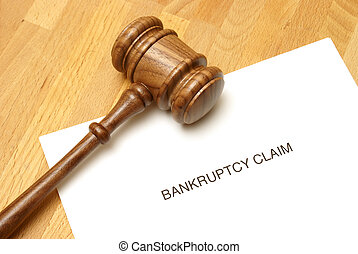 Bankruptcy forms and a gavel to represent this monetary...