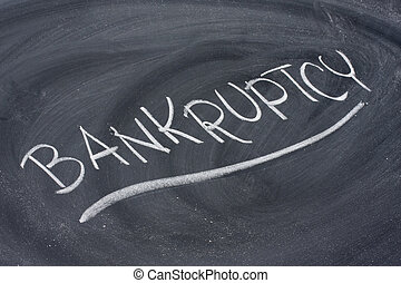 bankruptcy word on blackboard - bankruptcy word in white...