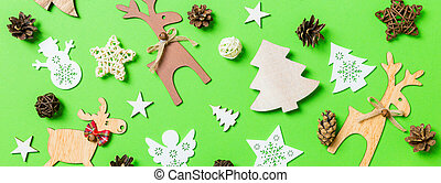 Banner Christmas green background with holiday toys and decorations. Happy New Year concept