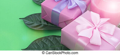Banner Holiday poster Boxes with gifts a glass of milkshake a bright green background.