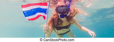 BANNER, LONG FORMAT Happy woman in snorkeling mask dive underwater with tropical fishes with thailand flag in coral reef sea pool. Travel lifestyle, water sport outdoor adventure, swimming lessons on summer beach holiday