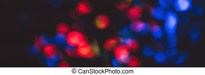 Banner of red and blue blurred lights on the street