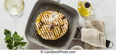 banner of swordfish steak fried on grill pan with olive oil ...
