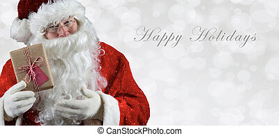 Banner sized inage with Santa Claus holding a present