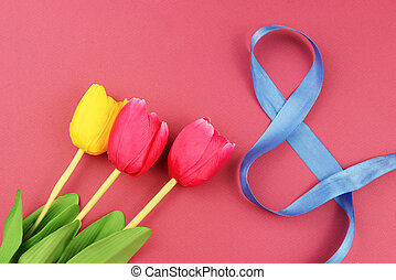 banner with red yellow tulips flowers on a pink background