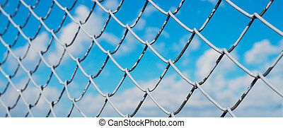 banner wor website, A fence made of wire mesh, netting covered with white on the background of blue sky and sunshine