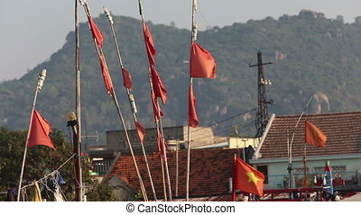 banners flap on fishing landing-nets in vietnamese city