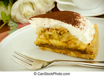 Banoffee pie on wooden plate