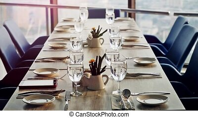 Banquet decorated table, with cutlery. Close up of elegant,...