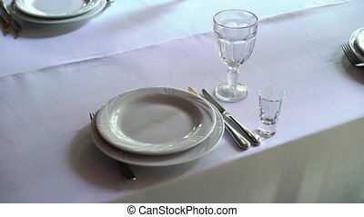 Banquet decorated table, with cutlery. Wedding decor in the...
