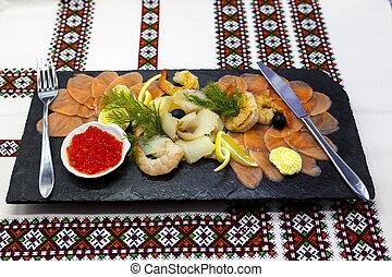 Banquet menu. Fish assortment on a beautiful black platter ...