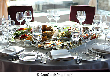 Banquet table in restaurant with different snacks