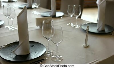 Banquet table set. Empty wine glasses on table. Table served...