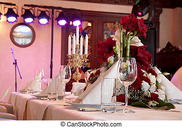 BANQUET TABLE - Tables set and salad served for a wedding...