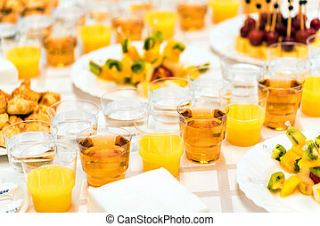 Banquet table with snacks and drinks close
