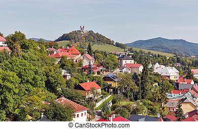 Banska Stiavnica townscape with view over Calvary on the hill, Slovakia.