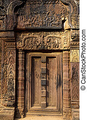 Elaborate sandstone carvings on the 12th century Hindu/Buddhist temple of Banteay Srei in the UNESCO World Heritage archaeological park of Angkor Wat near Siem Reap- Cambodia