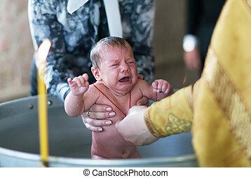 Baptism of infant in Orthodox Church. Sretenskaya church, Vladimir, Russia