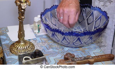 Baptism of water - Orthodox priest baptizes water before...