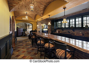 Elegant basement bar and stools in luxury home