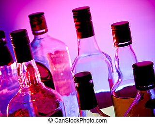 Various bottles at a bar arragged in rows