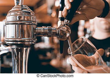 Bar - Chrome beer taps with highlights in the pub