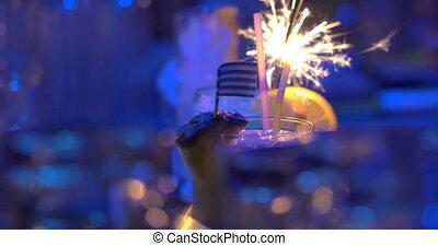 Bar cocktails with sparkler and Greek flag